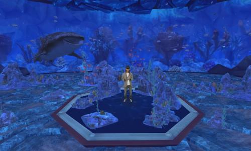 Microsoft's Alex Kipman appears in a holographic aquarium.